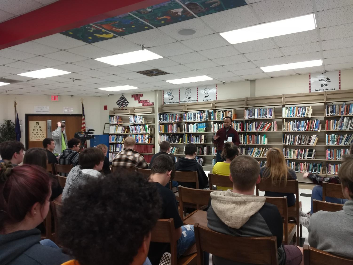 Poet mentor Rashad from Southern Word directs the poetry slam.