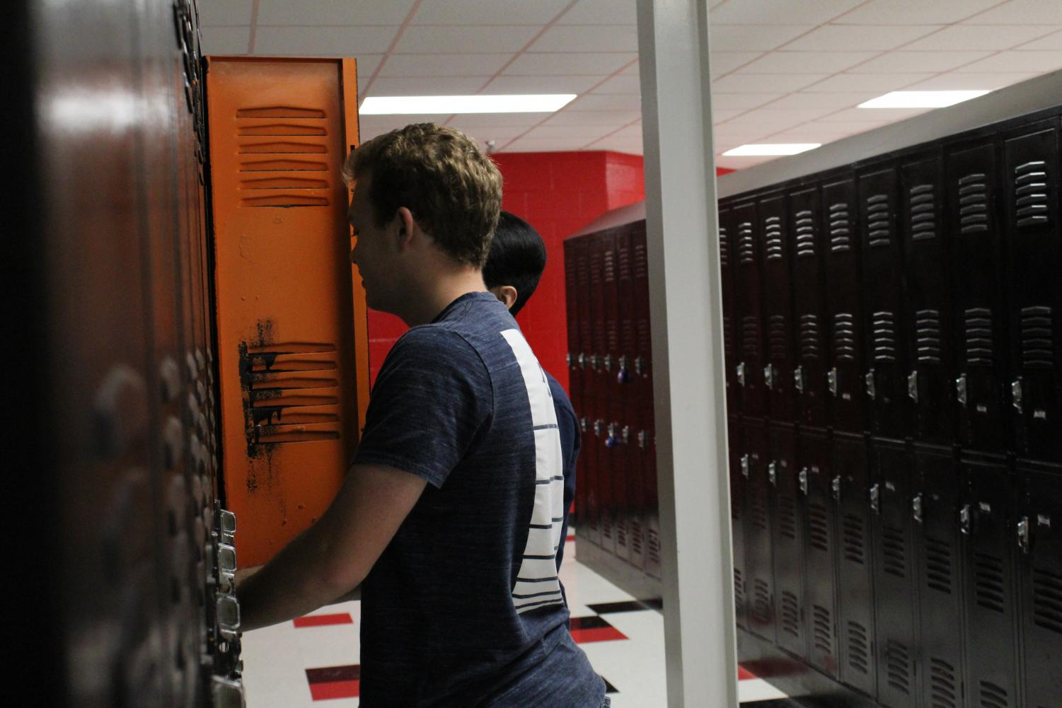 Students Austin Farris, and Ferdinand Ngo  at their lockers