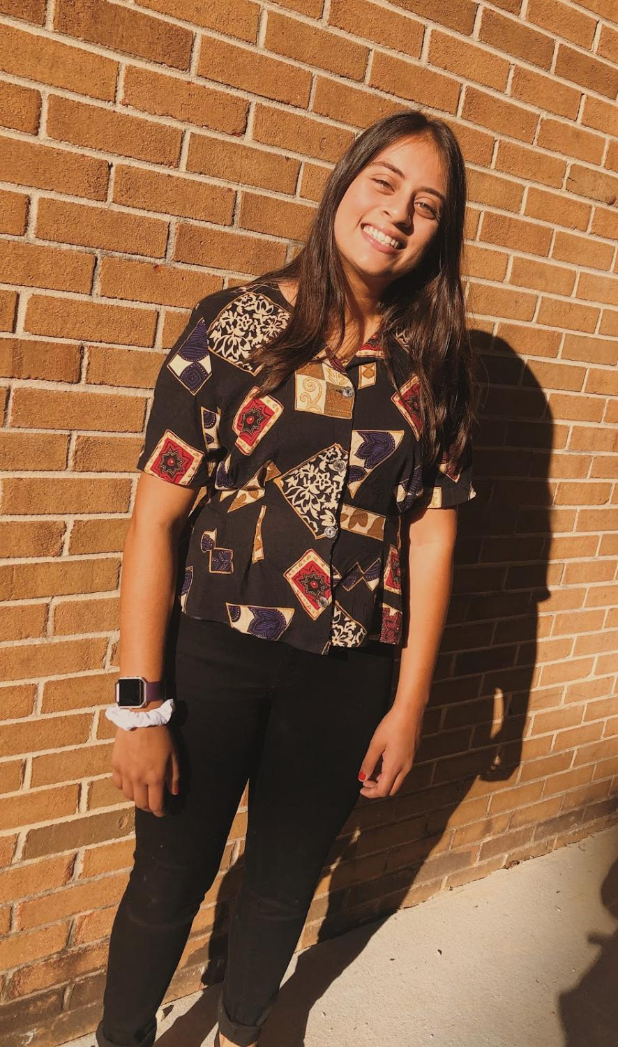 Kushi Zaver wears her upcycled shirt  that was originally an old dress.