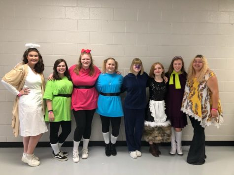 The Hive members from left to right, Emma Holmes, Madylyn Holder, Mariah Black, Hanna Brock, Madison Hershman, Sarah Thomas, Kailee Shores and Liberty McAfee, pose on Halloween in their costumes.
