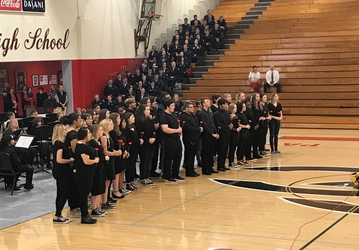 """The CCCHS choir sings """"In Flanders Fields,"""" a song inspired by a poem of the same name by John McCrae."""