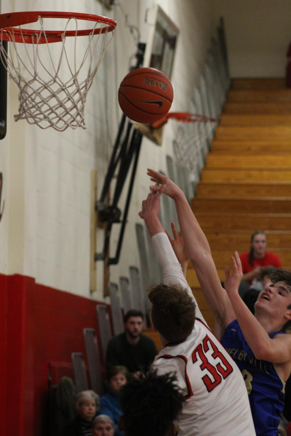 A CCCHS Red Raider successfully blocks a shot from Shelbyville Central.