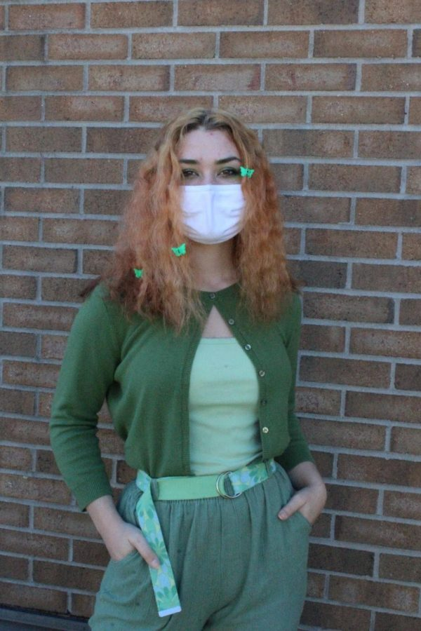 Cassidy, a fan of thrifting, rocks an all green, thrifted outfit to school.
