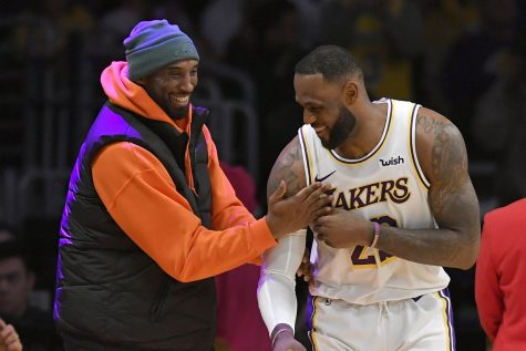 Kobe Bryant and Lebron James share a moment during a Lakers game.