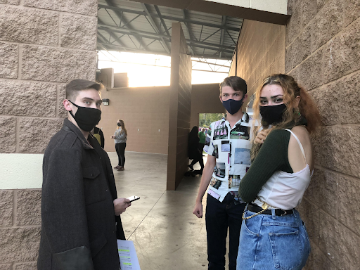 From left to right: Dale Hoffman, Tanner Maccagnone, and Cassidy Rose in a masked rehearsal of Taming of the Shrew.
