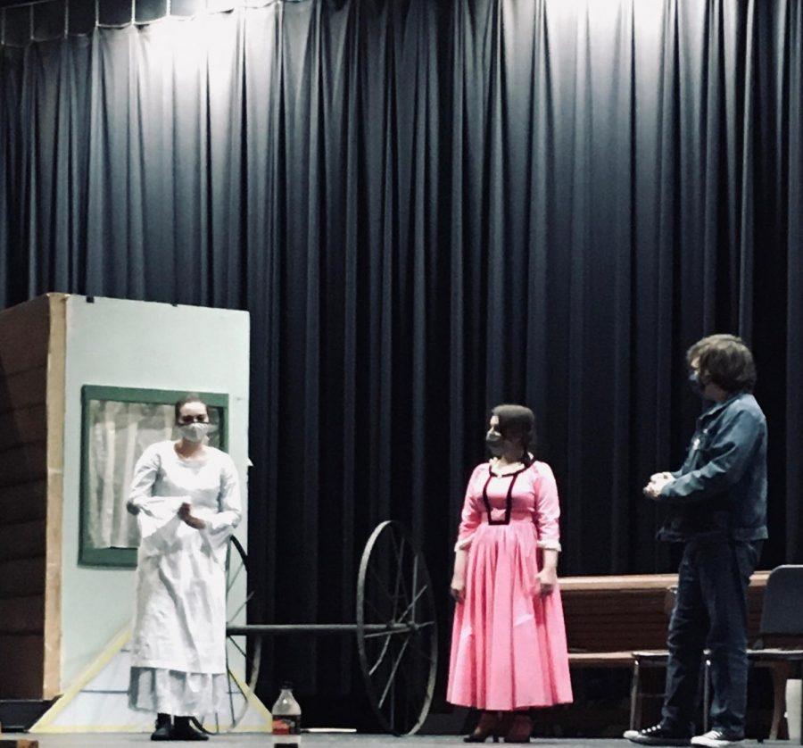 "Faith Duke (left), Alyssa Freeze (middle), and Donovan Katro (right) practice a scene from ""Oklahoma!""."