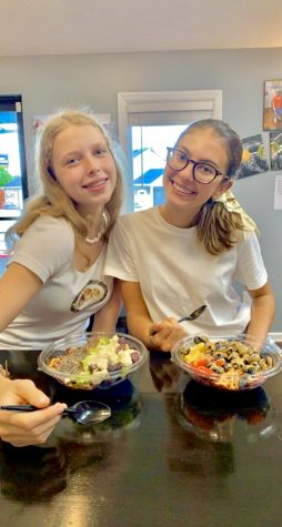 Frenge (Germany) and Louvrier (Belgium) enjoy a local restaurant, T-Town Smoothie Cafe.