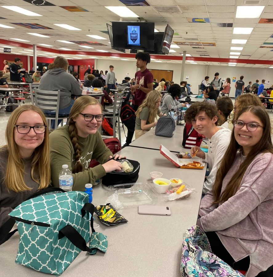 Sophomores enjoy third lunch as they discuss the new high school!