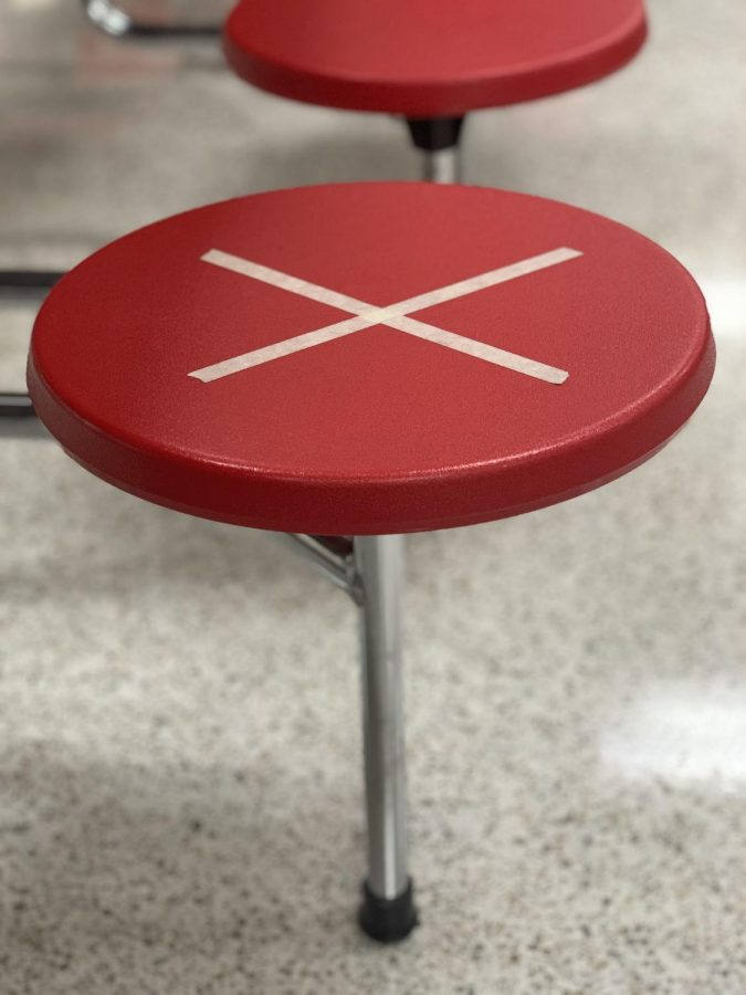 Social distancing markers were put into our cafeteria to separate groups of students.